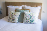Soft pillows on a comfortable bed — Stock Photo