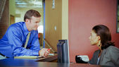 Businessman and Receptionist — Stock Photo