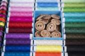 Sewing kit. Colored thread, pins, buttons, ribbons, safety pin. — Stock Photo
