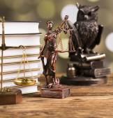 Golden scales of justice, books, Statue of Lady Justice. Owl and paragraph — Stock Photo
