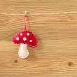 Red and white handmade mushroom on wooden background, Christmas decoration — Stock Photo #54232629