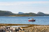 Beautiful landscape in Norway - lonely fishers' boat and mountains background — Stock Photo
