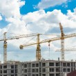 Construction site with cranes and blue sky background — Stock Photo #58032513