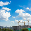 Construction site with cranes and blue sky background — Stock Photo #58032679