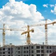 Construction site with cranes and blue sky background — Stock Photo #58033451