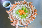Circular of claw crab on dish with seafood sause — Stock Photo