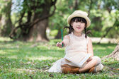 Little asian girl show pencil for writing book with smiling face — Stock Photo
