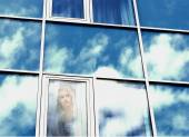 Double exposure Windows of a building with reflective clouds, girl — Stock Photo