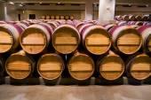 Wine barrels in winery cellar — Stock Photo