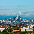 Los Angeles with snowy mountains — Stock Photo #77606114