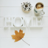 Cup of coffe, donut, yellow maple leaf and word home on white background — Stock Photo