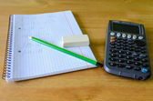 Workplace, study place with calculator, workbook and pencil — Stock Photo