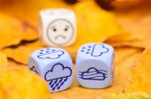 Depressing and sad weather of autumn shown on dice — Stock Photo
