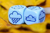 Weather of autumn shown on dice weather — Stock Photo