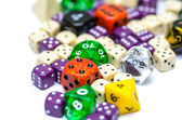 Multiple colorful role playing dices lying on isolated background — Stock Photo