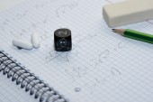 Study place with painkillers in background and skull dice — Stock Photo