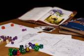 Role playing game set up on table isolated on black background — Stock Photo