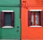 Green and orange houses in Burano island Italy — Stock Photo