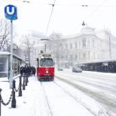 Tram on road in winter — Stock Photo
