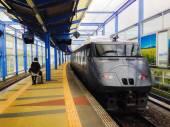 Train at railway station — Stock Photo