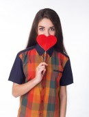 Beautiful model with red heart — Stock Photo