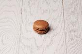 Macaroon on white wooden table — Stock Photo