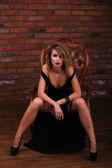 Woman posing in chair — Foto Stock