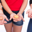 Hands holding sweet macaroons — Stock Photo #65789877