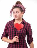 Housewife holding heart on the stick — Stock Photo