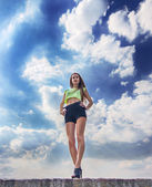 Fitness girl on the sky background — Foto Stock