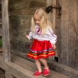 Little girl in ukrainian national costume are going for a walk — Stock Photo #58512115