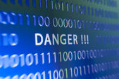 Danger inscription on monitor — Stock Photo