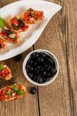 Bruschetta and olives — Stock Photo