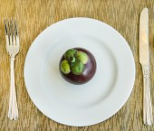 Mangosteen on the white plate — Stock Photo
