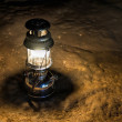 Storm lantern in a cave — Stock Photo #67353861