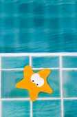 Starfish card by swimming pool — Stock Photo