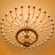 Beautiful crystal chandelier in a room — Stock Photo #68563507