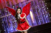 Pretty Asian girl in Santa costume for Christmas with night light — Stock Photo