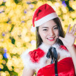 Pretty Asian girl in Santa costume for Christmas with night ligh — 图库照片 #70598781