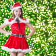 Pretty Asian girl in Santa costume for Christmas with night ligh — 图库照片 #70598801