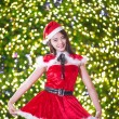 Pretty Asian girl in Santa costume for Christmas with night ligh — 图库照片 #70598943