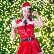 Pretty Asian girl in Santa costume for Christmas with night ligh — ストック写真 #70599055