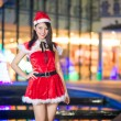 Pretty Asian girl in Santa costume for Christmas with night ligh — ストック写真 #70599289
