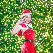 Pretty Asian girl in Santa costume for Christmas with night ligh — ストック写真 #70599401