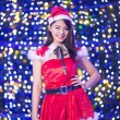 Pretty Asian girl in Santa costume for Christmas with night ligh — ストック写真 #70599417
