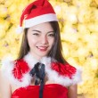 Pretty Asian girl in Santa costume for Christmas with night ligh — 图库照片 #70599459