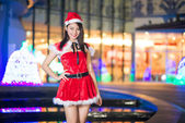 Pretty Asian girl in Santa costume for Christmas with night ligh — Stock fotografie