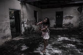Zombie girl in haunted house — Stock Photo