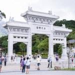 Po Lin Monastery, HONG KONG - JUNE 09: Tourists walk in the courtyard of Po Lin Monastery at the Lantau island on JUNE 09, 2015 in Hong Kong. — Stock Photo #76744319