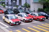 HONG KONG - JUNE 08: Taxis on the street on JUNE 08, 2015 in Hong Kong. Over 90 percent daily travelers use public transport. Its the highest rank in the world. — Stock Photo